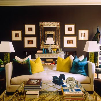 Philip Gorrivan Design - living rooms - peacock blue pillows, peacock blue velvet pillows, bamboo mirror, gold bamboo mirror, yellow pillows, glass and brass coffee table, settee, tufted settee,