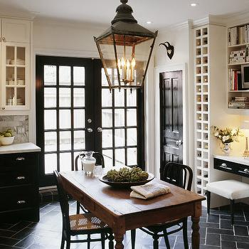 kitchens - two tone cabinets, white upper cabinets black lower cabinets, white upper cabinets and black lower cabinets, black and white kitchen, black herringbone floor, black herringbone tiles, black herringbone tiled floor, farmhouse dining table, black dining chairs, kitchen lantern, black french doors, builtin wine rack, kitchen desk, kitchen office,