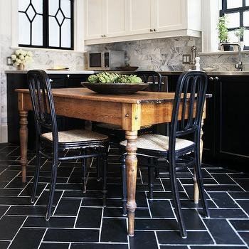 kitchens: two tone cabinets, white upper cabinets black lower cabinets, white upper cabinets and black lower cabinets, black and white kitchen, black herringbone floor, black herringbone tiles, black herringbone tiled floor, farmhouse dining table, black dining chairs,