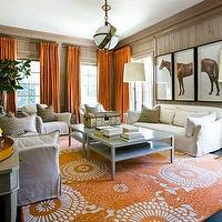 Melanie Turner Interiors - living rooms - orange drapes, orange curtains, orange window panels, orange curtains, orange drapes, orange window panels, zodiac pendant, orange rug, white and orange rug, slipcovered sofa, paneled walls, triptych art, horse triptych art, square coffee table, side by side coffee tables, Sandy Chapman Zodiac Pendant,