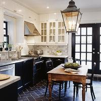 kitchens - glass-front, white upper cabinets, black lower cabinets, black, tiles, floor, herringbone, chevron, pattern, white, carrara, marble, countertops, subway tiles, backsplash, stinless steel, countertops, rustic, farmhouse, dining table, black, cafe, chairs, glossy, black, French doors, lantern,