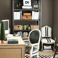 Ashley Goforth Design - dens/libraries/offices - black and white chair, black and white arm chair, , round black chair, parsons bookcase, parsons bookshelf, grasscloth desk, fabric wrapped desk, zebra rug, striped chair, black and white striped chair, black bookcase, black bookshelf, black parsons bookcase, black parsons bookshelf,