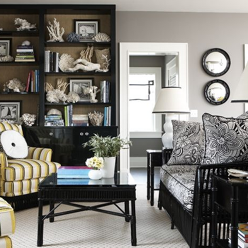 Michael Partenio - dens/libraries/offices - bullnose mirror, black bullnose mirror, black built ins, black built in cabinets, glossy black built ins, glossy black built in cabinets, black coffee table, wicker sofa, black wicker sofa, striped armchairs,