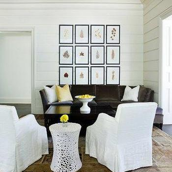 Melanie Turner Interiors - living rooms - dark brown sofa, velvet sofa, dark brown velvet sofa, dark brown velvet couch, velvet couch, slipcovered chairs, white slipcovered chairs, art gallery over sofa, paneled walls, horizontal wall panels,