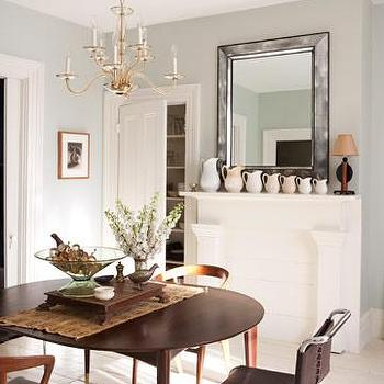 House Beautiful - dining rooms - antiqued beveled mirror, mid century dining table, mismatched dining chairs, mid century modern dining table,