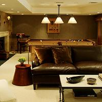 Nathan Egan - basements - taupe, grasscloth, wallpaper, pool table, chocolate brown, leather, sectional, sofa, nailhead trim, fireplace, iron, cocktail table, game room, basement game room, brown leather sofa, pool table, basement pool table, tray ceiling, basement tray ceiling, basement fireplace, game room fireplace,