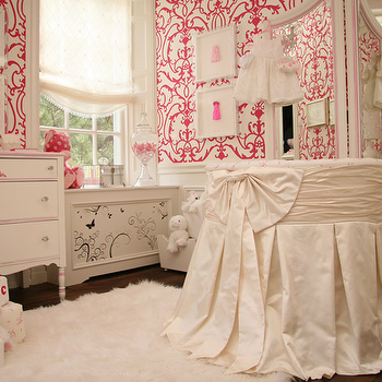 Patricia Halpin Interiors - nurseries - round crib, round crib nursery, girl round crib, girls round crib, skirted round crib, nursery wainscoting, wainscoting in nursery, damask wallpaper, pink damask wallpaper, hot pink damask wallpaper, white and pink damask wallpaper, french chest, nursery chest, nursery wallpaper, wallpaper for nursery, girls nursery,