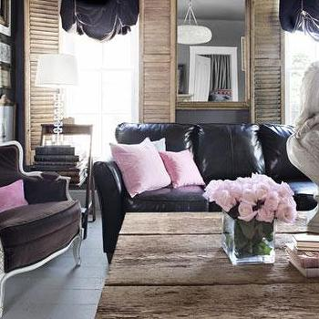 Country Living - living rooms - black couch, black sofa, black leather couch, black leather sofa, pink pillows, reclaimed wood coffee table, salvaged wood coffee table, bergere chair, brown bergere chair, velvet bergere chair, brown velvet bergere chair, white plank floors, black ruched shades, ruched shades,