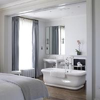 bathrooms - bathtub in bedroom, bathtub in master bedroom, master bedroom bathtub, bedroom bathtub, tub in bedroom, tub in master bedroom, master bedroom tub, freestanding tub, freestanding bathtub, parisian pedestal sink, bathroom fireplace, blue curtains, blue silk curtains, Roman Bathtub,