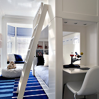 White & blue modern boy's bedroom design with white bunk beds, desk area, white & ...