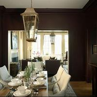 Westbrook Interiors - dining rooms - chocolate, brown, walls, ivory, drapes, lantern, rustic, wood, trestle, dining table, slipcovered, dining chairs, lantern, art, buffet,