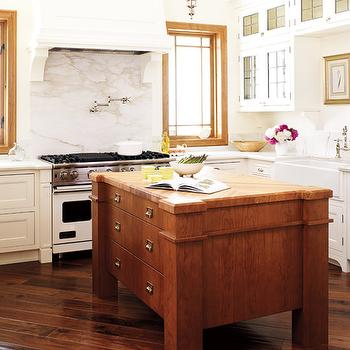 Style at Home - kitchens - chunky kitchen island, two tone kitchen, glass front kitchen cabinets, leaded cabinets, leaded kitchen cabinets, diagonal wood floors,