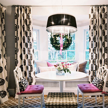 Lonny Magazine - dining rooms - black and white curtains, black and white drapes, ikea docksta, ikea dining table, magenta cushions, built in bench, built in banquette, gingham cushion, black and white gingham cushion, lattice rug, Romo Fabrics Miraflores Floresca Charcoal Fabric, Ikea Docksta Table,