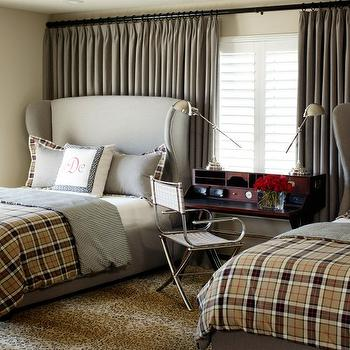 Tobi Fairley - boy's rooms - light gray headboards, light gray wingback headboards, curtains behind bed, curtains behind headboard, monogrammed pillows, shared kids room, shared boys room, shared nightstand, desk as nightstand, plaid bedding, boys bedding, gray curtains, gray drapes, gray window panels,