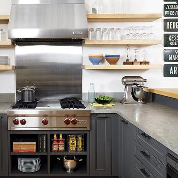 Style at Home - kitchens - charcoal gray cabinets, charcoal gray kitchen cabinets, grey countertops, floating shelves, kitchen floating shelves, shelves flanking stove, shelves flanking cooktop,