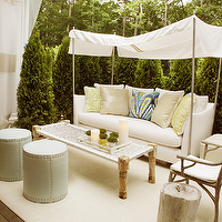 Elsa Soyars - decks/patios - white, sofa, outdoor, rug, blue, green, metallic, beige, pillows, blue, gray, ottomans, nailhead trim, branch, chairs, Trina Turk Peacock Print Fabric, Currey & Co. Woodland Armchair, Lee Industries Drum Ottoman,