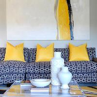 Tobi Fairley - living rooms - yellow and blue living room, yellow pillows, blue sectional, blue sectional sofa, blue patterned sectional, patterned sectional, lucite coffee table, square lucite coffee table, yellow and blue rug, yellow and blue art, yellow and blue abstract art,