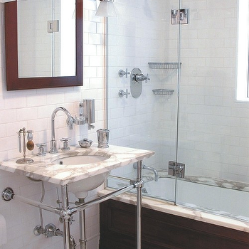 Tara Seawright - bathrooms - subway tiles, shower surround, subway tile shower, white subway tile, subway tile bathroom, white subway tile bathroom, white subway tile shower, shower partition, wood paneled bathtub, paneled drop in tub, dark paneled bathtub, marble washstand,