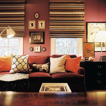 Lonny Magazine - living rooms - mauve walls, mauve sofa, mauve velvet sofa, velvet sofa, black end table, chest as end table, striped roman shades, Windsor Smith Riad Fabric,