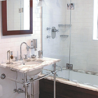 Tara Seawright - bathrooms - calcutta, marble sink, countertop, polished chrome, base, legs, espresso, mirror, sconces, subway tiles, shower surround, subway tile shower, white subway tile, subway tile bathroom, white subway tile bathroom, white subway tile shower,