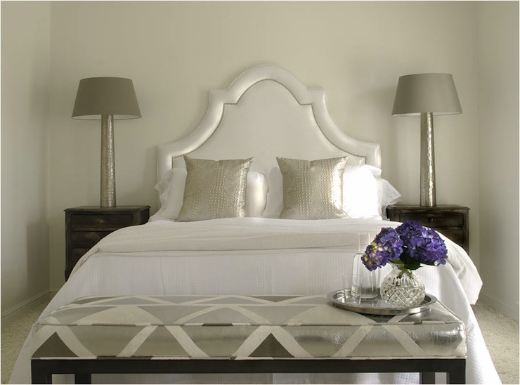 Caldwell Flake - bedrooms - antiqued mirrored lamps, gray lamp shades, black nightstands, metallic headboard, metallic pillows, silver pillows, gray bench, geometric bench, gray geometric bench,