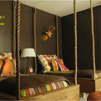 Caldwell Flake - boy's rooms - hanging beds, hanging rope bed, rope hanging bed, suspended beds, rope suspended beds, brown blankets, reclaimed wood bed, s chocolate brown walls, shared kids room, shared kids bedroom,
