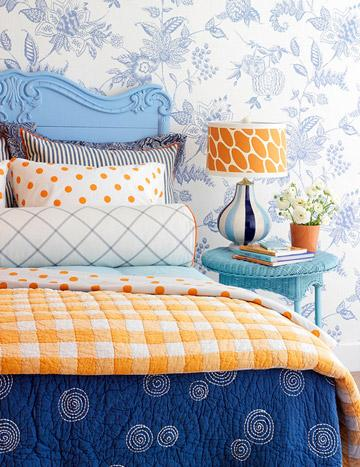 bedrooms - blue and orange bedroom, blue headboard, orange lamp shade, blue and orange bedding, turquoise nightstand, turquoise wicker table,