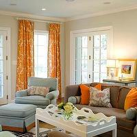 Palmer Weiss - living rooms - orange curtains, orange drapes, orange window panels, orange damask curtains, orange damask drapes, orange damask window panels, damask curtains, damask drapes, damask window panels, brown sofa, orange pillows, brown sofa with orange pillows, white coffee table, scalloped coffee table,