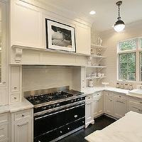 Oxford Development - kitchens - black and white kitchen, paneled range hood, hicks pendants, kitchen hicks pendants, white kitchen cabinets, calcutta marble, calcutta marble countertops, kitchen shelves, Thomas O'Brien Hicks Pendant,