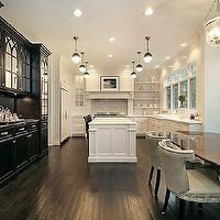 Oxford Development - kitchens - black, built-ins, buffet, hutch, mirrored doors, white, glass-front, kitchen cabinets, calcutta, marble, counter tops, taupe, leather, dining chairs, nailhead trim, subway tiles, backsplash, topiary, double sinks, oval, walnut, dining table, leather, dining chairs, nailhead trim, black and white kitchen, Thomas O'Brien Hicks Pendant,