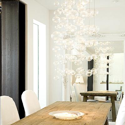 dining rooms - white baroque floor mirror rustic wood dining table white slipcovered dining chairs glass bubbles pendant chandelier  Mark English