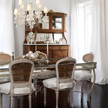House & Home - dining rooms - crystal chandelier, french table, french dining table, trestle dining table, cane dining chairs, gray dining chairs, gray cane chairs, gray cane dining chairs, french dining room, gray dining table, gray french chairs,