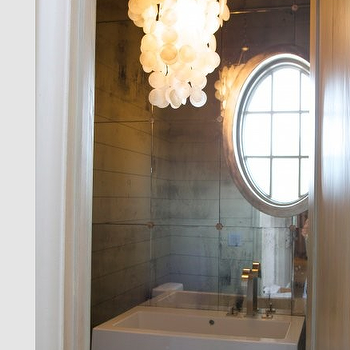 Tracery Interiors - bathrooms - mirror backsplash, mirrored backsplash, bathroom mirror backsplash, bathroom mirrored backsplash, capiz chandelier, white capiz chandelier, oval window,