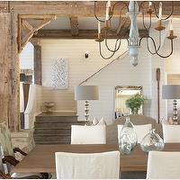 Tracery Interiors - dining rooms - recycled, glass bottles, walnut, dining table, slipcovered, dining chairs, gray, turquoise, blue, floral, captain chairs, chandelier, silver, lamps, beveled, mirror, exposed wood beams, white, wood paneling,
