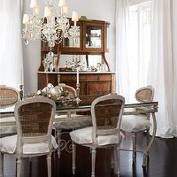 House & Home - dining rooms - gray, walls, gray, cane back, French, dining chairs, gray, glass-top, dining table, espresso, wood floors, white, silk, drapes, antique, buffet, hutch, crystal chandelier, french table, french dining table, trestle dining table,
