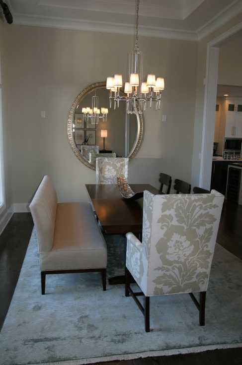 Suzie: Fowler Interiors - White &amp; gray elegant formal dining room with oval silver mirror, ...
