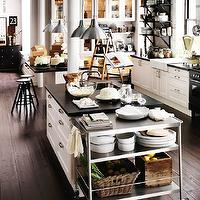 Ikea - kitchens: gray, walls, ikea kitchen, white, glass-front, kitchen, cabinets, kitchen, island, black, countertops, farmhouse sink, black, stools, stainless steel, rolling cart,