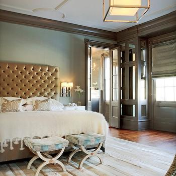 Stylish master bedroom with great architectural details, custom cowhide rug, ...