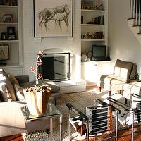 living rooms - camel, white, ivory, hardwood, brick, fireplace, armless chairs, bookshelves.,  photo via Kitchen Lab
