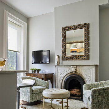 CWB Architects - living rooms - greek key, greek key mirror, stone fireplace, swivel chairs, barrel back chairs, white leather ottoman, antique brass ottoman, gray green walls, Greek Key Mirror - Shagreen,