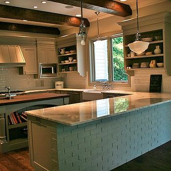 August Fields - kitchens - gray green kitchen cabinets, gray green cabinets, beveled subway tile, beveled subway tile backsplash, apron sink, white apron sink, microwave nook, kitchen peninsula, wood beams, kitchen wood beams, wood beams in kitchen, schoolhouse pendant,
