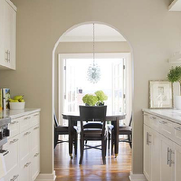 Bosworth Hoedemaker - kitchens - galley kitchen, white galley kitchen, traditional galley kitchen, galley kitchen design, galley kitchen cabinets, white galley cabinets, white galley kitchen cabinets, arched doorway, Recycled Glass Grape Lamp,