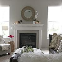 House Tweaking - living rooms - gray, walls, round, mirror, fireplace, gray, slipper chair, espresso, leather, sectional, sofa, tufted, ottoman, pillows, white, sheers,