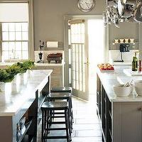 Martha Stewart - kitchens - black, industrial stools, calcutta, marble, countertops, gray, painted, kitchen cabinets, pot rack, gray, walls, martha stewart kitchen, martha stewart kitchen cabinets, martha stewart cabinets,