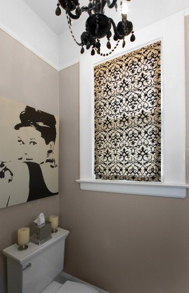 bathrooms - greige walls glossy black chandelier Ikea Audrey Hepburn Breakfast at Tiffany's canvas print tan black roman shade  Amoroso Design