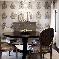 Amoroso Design - dining rooms - charcoal, gray, silver, wallpaper, accent wall, black, round, dining table, gray, damask, Louis, dining chairs, nailhead trim, painted, gray, chest, buffet, cabinet, mercury glass, vases, accents, white, silk, drapes, gray, walls, Romo Wallpaper, Sergei Pendant,