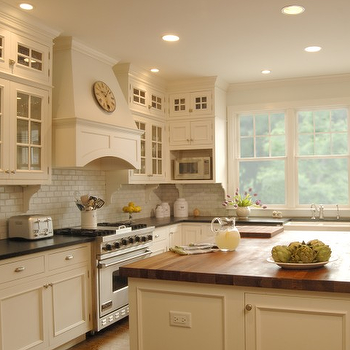 Kitchen Studio of Glen Ellyn - kitchens - farmhouse sink, island with butcher block top, kitchen island with wood top, kitchen island with butcher block top, cream cabinets, cream kitchen cabinets, butcher block countertops,