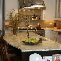 Kitchen Studio of Glen Ellyn - kitchens - curved countertops, curved island countertops, curved kitchen island, gray tiles, gray tiled kitchen, gray tile backsplash, two tone cabinets, black kitchen cabinets, built in plate rack, island plate rack, kitchen island plate rack, , Restoration Hardware Harmon Pendant,