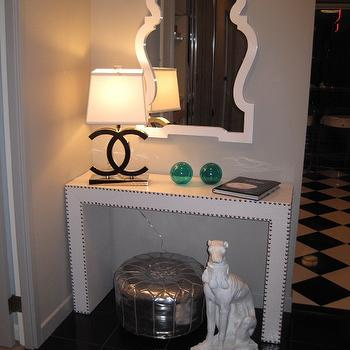 entrances/foyers - silver pouf, chanel lamp, interlocking c lamp, nailhead console table, white console table, studded console table, queen anne mirror, white mirror, foyer mirror, Jonathan Adler Queen Anne Mirror, Interior Illusions CC Lamp,