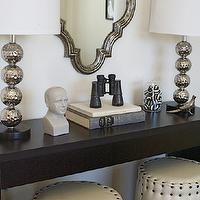 Caitlin Creer Interiors - entrances/foyers - hammered metal, stacked ball, lamps, cream, round, ottomans, stools, nailhead trim, espresso, console, table, pewter, mirror, Chase Pedestal Ottoman, Phrenology Head,